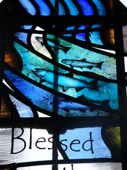 Detail view of the stained glass window design by glass artist Derek Hunt at St. Peter & St. Thomas Becket Church, Stambourne