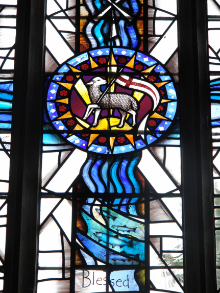 Detail view of the Lamb of God in the central lancet to the stained glass window design by glass artist Derek Hunt at St. Peter & St. Thomas Becket Church, Stambourne