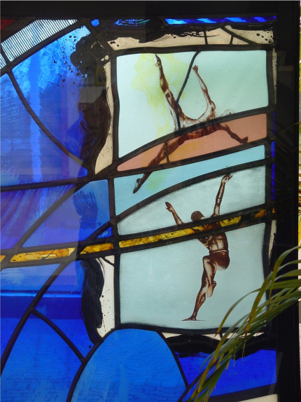 Latimer Theatre, Kettering architectural glass panel design by glass artist Derek Hunt depicting two dancers in full flight with painted abstract background