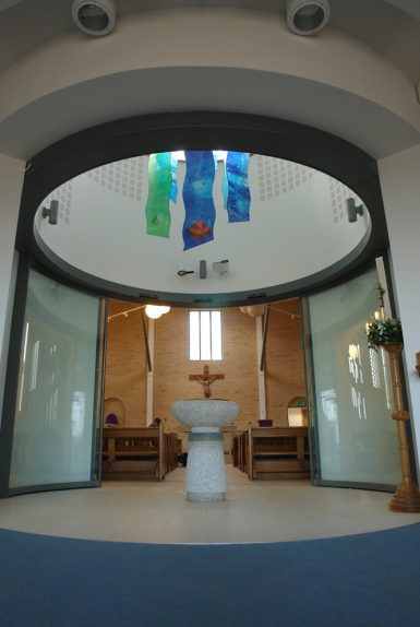 St Felix Church, Haverhill - context view of architectural glass design with font by glass artist Derek Hunt FMGP