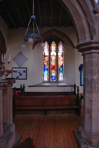 Context view of stained glass window design at St Helena's Church, Waltham on the Wolds by glass artist Derek Hunt FMGP
