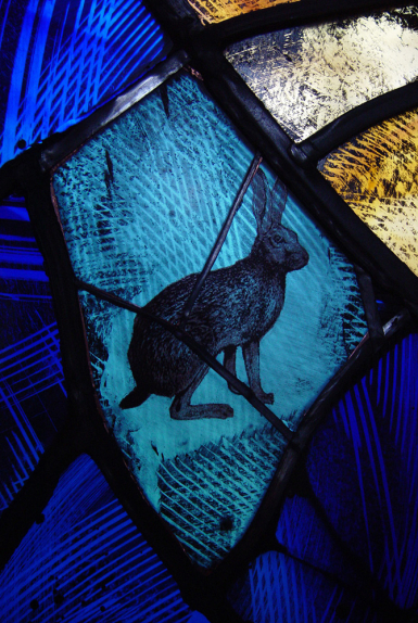 Painted, screen printed background on stained glass to illustration of hare by glass artist Derek Hunt at Waltham on the Wolds
