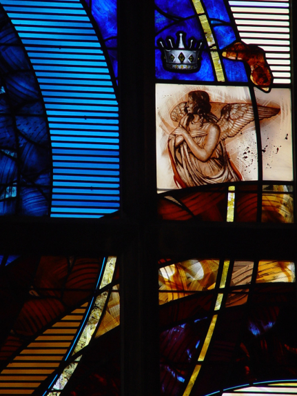 St. John the Evangelist Church detail showing middle right lancets with angel in in deep reds, oranges and blue for stained glass window design by Derek Hunt