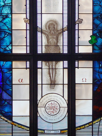 St. John the Evangelist Church, Seven Kings, Essex central lancets from stained glass window design by glass artist Derek Hunt with Christ on the cross, text and outline of the church