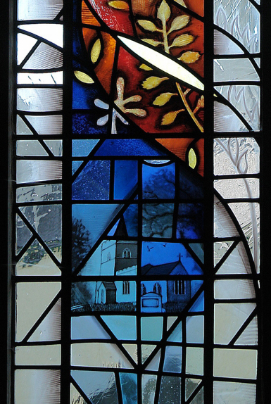 Detail depicting St Mary's Church and memorial in the hand painted stained glass window design by glass artist Derek Hunt FMGP