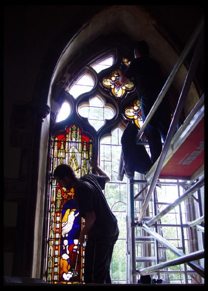 Removal of stained glass window panels prior to fitting isothermal glazing