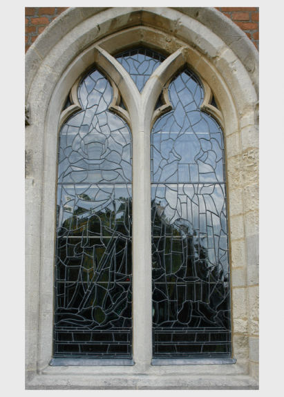 Exterior view of isothermal glazing to a stained window