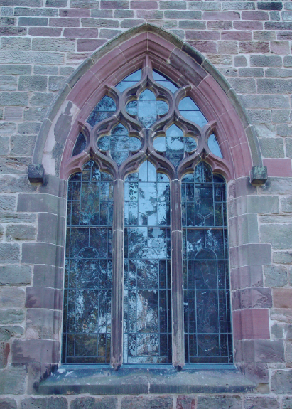 Exterior view of stained glass window before isothermal glazing installed
